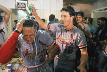 LOS ANGELES - OCTOBER 16: Andy Van Slyke #18 of the St. Louis Cardinals pours champagne on teammate Tito Landrum #21 during their celebration their win against the Los Angeles Dodgers in Game 6 of the National League Championship Series on October 16, 198
