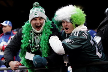 EAST RUTHERFORD, NJ - JANUARY 11:  Fans of the Philadelphia Eagles celebrate against the New York Giants during the NFC Divisional Playoff Game on January 11, 2009 at Giants Stadium in East Rutherford, New Jersey.  (Photo by Michael Heiman/Getty Images)