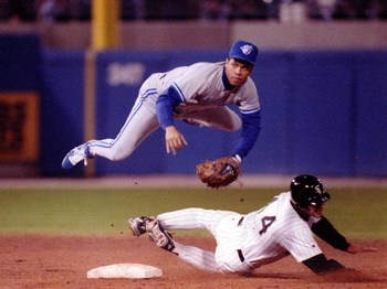 Roberto Alomar of the Toronto Blue Jays goes airbourne over Chicago White Sox Dan Pasqua to convert the double play. Mandatory Credit: Jonathan Daniel/ALLSPORT