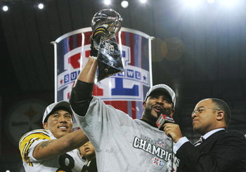 DETROIT - FEBRUARY 05:  Running back Jerome Bettis #36 (M) and game MVP wide receiver Hines Ward #86 of the Pittsburgh Steelers celebrate with the Vince Lombardi Tropy after defeating the Seattle Seahawks in Super Bowl XL at Ford Field on February 5, 2006