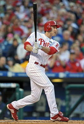 PHILADELPHIA - APRIL 17: Chase Utley #26 of the Philadelphia Phillies watches the ball going into the stands while hitting a 2 run home-run in the bottom of the first inning during the game against the San Diego Padres on April 17, 2009 at Citizens Bank P