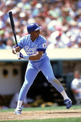 OAKLAND, CA - 1990:  Frank White #20 of the Kansas City Royals stands ready at the plate during a game against the Oakland Athletics at Oakland-Alameda County Coliseum in 1990 in Oakland, California.  (Photo by Otto Greule Jr/Getty Images)