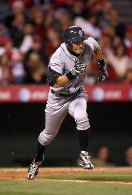 ANAHEIM, CA - APRIL 24:  Ichiro Suzuki #51 of the Seattle Mariners runs to first in the game with the Los Angeles Angels of Anaheim on April 24, 2009 at Angel Stadium in Anaheim, California. The Mariners won 8-3.  (Photo by Stephen Dunn/Getty Images)