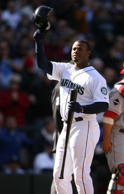 SEATTLE - APRIL 14:  Ken Griffey Jr. #24 of the Seattle Mariners acknowledges the crowd during his first at-bat against the Los Angeles Angels of Anaheim during the Opening Day game on April 14, 2009 at Safeco Field in Seattle, Washington. (Photo by Otto