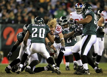 PHILADELPHIA - JANUARY 07:  Jeremy Shockey #80 of the New York Giants reaches for more yardage after having his helmet knocked off by the Philadelphia Eagles during their NFC Wildcard Playoff game on January 7, 2007 at Lincoln Financial Field in Philadelp