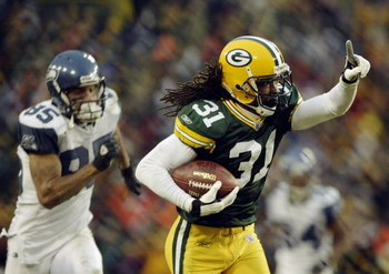 GREEN BAY, WI - JANUARY 4:  Cornerback Al Harris #31 of the Green Bay Packers returns an interception 52-yards for a touchdown in overtime to give the Packers a 33-27 victory in the NFC playoff game against the Seattle Seahawks on January 4, 2004 in Lambe