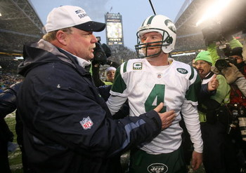 SEATTLE - DECEMBER 21:  Head coach Mike Holmgrem of the Seattle Seahawks is congratulated by quarterback Brett Favre #4 of New York Jets on December 21, 2008 at Qwest Field in Seattle, Washington. The Seahawks defeated the Jets 13-3. (Photo by Otto Greule