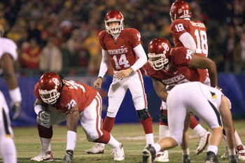 KANSAS CITY, MO - DECEMBER 06:  Quarterback Sam Bradford #14 of the Oklahoma Sooners calls the play at the line of scrimmage during the game against the Missouri Tigers on December 6, 2008 at Arrowhead Stadium in Kansas City, Missouri. (Photo by Jamie Squ