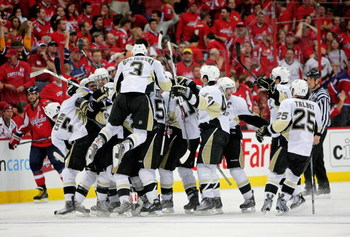 WASHINGTON - MAY 09:  Evgeni Malkin #71 of the Pittsburgh Penguins is mobbed by his teammates as they all celebrate Malkin's overtime winning goal over the Washington Capitals during Game Five of the Eastern Conference Semifinal Round of the 2009 Stanley
