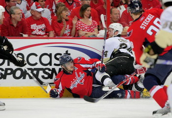 WASHINGTON - MAY 09:  Alex Ovechkin #8 of the Washington Capitals is dropped to the ice by Matt Cooke #24 of the Pittsburgh Penguins during Game Five of the Eastern Conference Semifinal Round of the 2009 Stanley Cup Playoffs on May 9, 2009 at the Verizon