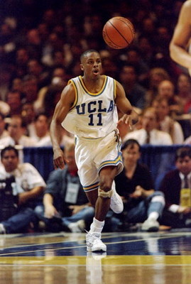23 Mar 1995: Guard Tyus Edney of the UCLA Bruins moves the ball during a game against the Mississippi State Bulldogs. UCLA won the game, 86-67.