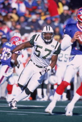 7 Oct 2001:  Mo Lewis #57 of the New York Jets moves in to tackle Rob Johnson #11 of the Buffalo Bills during the game at the Ralph Wilson Stadium in Orchard Park, New York.  The Jets defeated the Bills 42-36.Mandatory Credit: Rick Stewart/Allsport