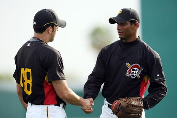 BRADENTON, FL - MARCH 27:  Rinku Singh (R) of the Pittsburgh Pirates thanks a teammate after getting some advice during practice at the Pirates minor league training facility on March 27, 2009 in Bradenton, Florida.  (Photo by Doug Benc/Getty Images)