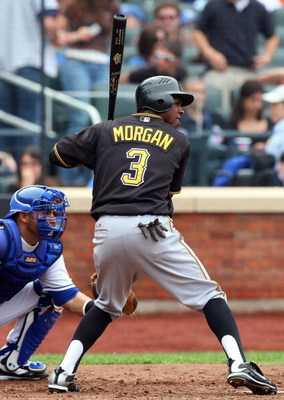 NEW YORK - MAY 09:  Nyjer Morgan #3 of the Pittsburgh Pirates bats against the New York Mets on May 9, 2009 at Citi Field in the Flushing neighborhood of the Queens borough of New York City. The Mets defeated the Pirates 10-1.  (Photo by Jim McIsaac/Getty