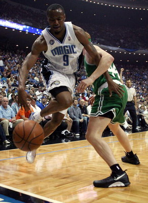 ORLANDO, FL - MAY 10: Rashard Lewis #9 of the Orlando Magic drives against Brian Scalabrine #44 of the Boston Celtics in Game Four of the Eastern Conference Semifinals during the 2009 NBA Playoffs at Amway Arena on May 10, 2009 in Orlando, Florida. NOTE T