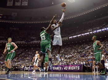 ORLANDO, FL - MAY 10:  Dwight Howard #12 of the Orlando Magic shoots against Kendrick Perkins #43 of the Boston Celtics in Game Four of the Eastern Conference Semifinals during the 2009 NBA Playoffs at Amway Arena on May 10, 2009 in Orlando, Florida. NOTE