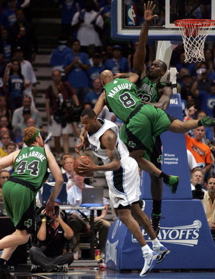 ORLANDO, FL - MAY 08:  Rashard Lewis #9 of the Orlando Magic (C) is fouled by Stephon Marbury #8  the Boston Celtics in Game Three of the Eastern Conference Semifinals during the 2009 NBA Playoffs at Amway Arena on May 8, 2009 in Orlando, Florida. NOTE TO