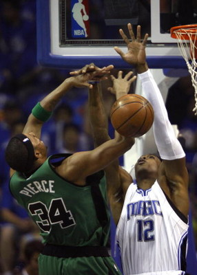 ORLANDO, FL - MAY 08:  Dwight Howard #12 of the Orlando Magic blocks a shot by Paul Pierce #34 of the Boston Celtics in Game Three of the Eastern Conference Semifinals during the 2009 NBA Playoffs at Amway Arena on May 8, 2009 in Orlando, Florida. NOTE TO