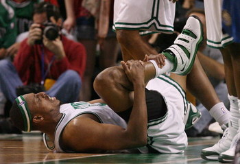 BOSTON - MAY 04:  Paul Pierce #34 of the Boston Celtics grabs his leg after being fouled in the second half against the Orlando Magic in Game One of the Eastern Conference Semifinals during the 2009 NBA Playoffs at TD Banknorth Garden on May 4, 2009 in Bo