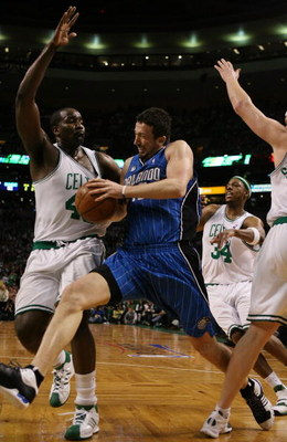 BOSTON - MAY 04:  Hedo Turkoglu #15 of the Orlando Magic tries to get by Kendrick Perkins #43, Paul Pierce #34 and Brian Scalabrine #44 of the Boston Celtics in Game One of the Eastern Conference Semifinals during the 2009 NBA Playoffs at TD Banknorth Gar