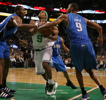BOSTON - MAY 04:  Dwight Howard #12 and Rashard Lewis #9 of the Orlando Magic strip the ball from Rajon Rondo #9 of the Boston Celtics in Game One of the Eastern Conference Semifinals during the 2009 NBA Playoffs at TD Banknorth Garden on May 4, 2009 in B