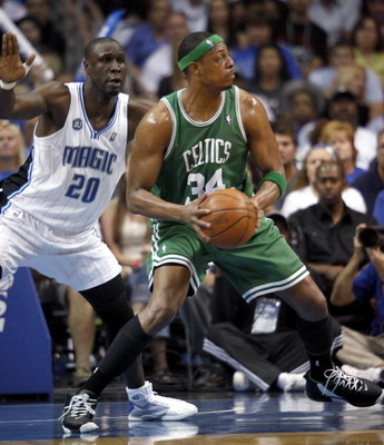 ORLANDO, FL - MAY 10:   Paul Pierce #34 of the Boston Celtics looks to pass against Mickael Pietrus #20 of the Orlando Magic in Game Four of the Eastern Conference Semifinals during the 2009 NBA Playoffs at Amway Arena on May 10, 2009 in Orlando, Florida.