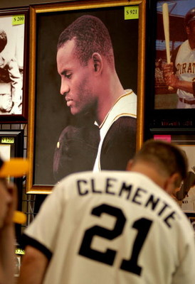 PITTSBURGH - JULY 7: Fans look over Roberto Clemente memorabilia during opening day of Fan Fest for the Major League Baseball 2006 All-Star game at the David L. Lawrence Convention Center July 7, 2006 in Pittsburgh, Pennsylvania. (Photo by Paul Hawthorne/