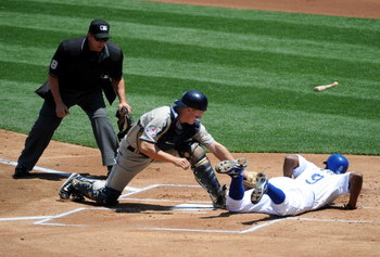 LOS ANGELES, CA - MAY 03:  Juan Pierre #9 of the Los Angeles Dodgers slides in safe ahead of the tag of Nick Hundley #4 of the San Diego Padres for a 1-0 lead during the first inning at Dodger Stadium on May 3, 2009 in Los Angeles, California.  (Photo by