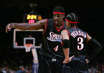 NEW YORK - NOVEMBER 26: Chris Webber #4 talks with Allen Iverson #3 of the Philadelphia 76ers talks in their game against the New York Knicks on November 26, 2005 at Madison Square Garden in New York City. NOTE TO USER: User expressly acknowledges and agr