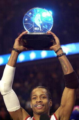 Basketball player Allen Iverson, #3 of the Philadelphia 76ers and the Eastern Conference All-Stars, holds aloft his MVP trophy following the NBA All-Star Game at the MCI Center in Washington, D.C., February 11, 2000. (Photo M. David Leeds/Allsport/Getty I