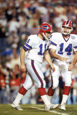 TAMPA, FL - JANUARY 27:  Kicker Scott Norwood #11 and  quarterback Frank Reich #14 of the Buffalo Bills walk n the field during Super Bowl XXV against the New York Giants at Tampa Stadium on January 27, 1991 in Tampa, Florida.  The Giants won 20-19.  (Pho