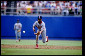 11 Jul 1992: Shortstop Ozzie Smith of the St. Louis Cardinals runs up to scoop up the ball during a game against the Los Angeles Dodgers at Dodger Stadium in Los Angeles, California.