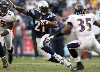 SAN DIEGO - NOVEMBER 25:  Runningback LaDainian Tomlinson #21 of the San Diego Chargers runs against the Baltimore Ravens en route to the Chargers's 32-14 win during their NFL Game at Qualcomm Stadium November 25, 2007 in San Diego, California. Tomlinson