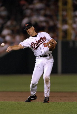 5 Sep 1995:  Shortstop Cal Ripken of the Baltimore Orioles throws the ball in a game against the California Angels at Camden Yards in Baltimore, Maryland during which Ripken tied Lou Gehrig''s record for number of consecutive games played at 2130.  The Or