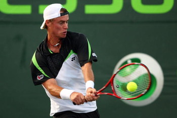 KEY BISCAYNE, FL - MARCH 27:  Lleyton Hewitt of Australia returns a shot against Gilles Simon of France during day five of the Sony Ericsson Open at the Crandon Park Tennis Center on March 27, 2009 in Key Biscayne, Florida.  (Photo by Clive Brunskill/Gett
