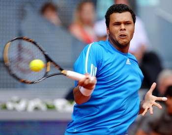 MADRID, SPAIN - MAY 11:  Jo-Wilfried Tsonga of France returns a backhand to Marat Safin of Russia in their first round match during the Madrid Open tennis tournament at the Caja Magica on May 11, 2009 in Madrid, Spain. Tsjonga won the match in two sets, 6
