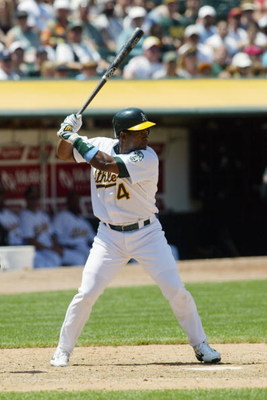 OAKLAND, CA - JUNE 15:  Infielder Miguel Tejada #4 of the Oakland Athletics at bat against the Montreal Expos at the Network Associates Coliseum durung their interleague game on June 15, 2003 in Oakland, California. The Athletics defeated the Expos 9-1. (