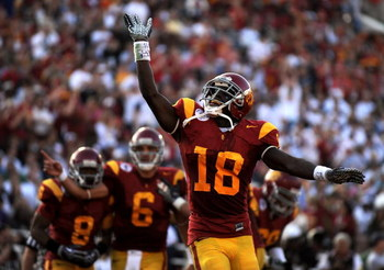 PASADENA, CA - JANUARY 01:  Damian Williams #18 of the USC Trojans celebrates a touchdown at the end of the first half against the Penn State Nittany Lions during the 95th Rose Bowl Game presented by Citi on January 1, 2009 at the Rose Bowl in Pasadena, C