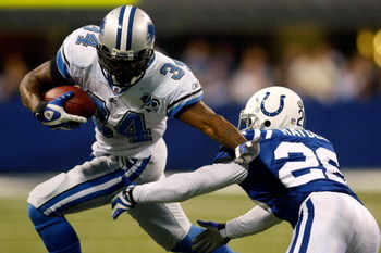 INDIANAPOLIS - DECEMBER 14:  Kevin Smith #34 of the Detroit Lions avoids a tackle by Kelvin Hayden #26 of the Indianapolis Colts on December 14, 2008 at Lucas Oil Stadium in Indianapolis, Indiana.  The Colts defeated the Lions 31-21.  (Photo by Chris Gray
