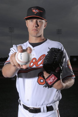 FORT LAUDERDALE, FL - FEBRUARY 23: Chris Tillman #8 of the Baltimore Orioles poses during photo day at the Orioles spring training complex on February 23, 2009 in Ft. lauderdale, Florida. (Photo by Marc Serota/Getty Images)