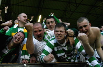 DUNDEE, UNITED KINGDOM - MAY 22:   Celtic fans celebrate after Jan Vennegoor of Hesselink of Celtic scored the first goal during the Clydesdale Bank Premier League match between Dundee United and Celtic at Tannadice Stadium on May 22, 2008 in Dundee, Scot