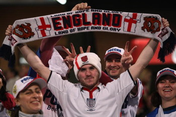 TEL AVIV, ISRAEL - NOVEMBER 17:  An England fan is surrounded by Russian fans at the start of the Euro 2008 qualifying match between Israel and Russia on November 17, 2007 at the national stadium in Ramat Gan near Tel Aviv, Israel.  (Photo by David Silver