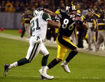 09 Dec 01:  Hines Ward #86 of the Pittsburgh Steelers stiff arms Victor Green #21 of the New York Jets during the third quarter at Heinz Field in Pittsburgh, Pa.  Digital Image. Mandatory Credit: NICK WASS/ALLSPORT