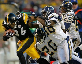 PITTSBURGH - DECEMBER 21:  Hines Ward #86 of the Pittsburgh Steelers picks up a first down as he is brought down by Terrence Keil #48, Jerry Wilson #20 and Donnie Edwards #59 of the San Diego Chargers on December 21, 2003 at Heinz Field in Pittsburgh, Pen