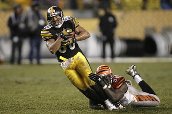 PITTSBURGH - DECEMBER 2:  Hines Ward #86 of the Pittsburgh Steelers is tackled during the NFL game against the Cincinnati Bengals at Heinz Field on December 2, 2007 in Pittsburgh, Pennsylvania. (Photo by Rick Stewart/Getty Images)