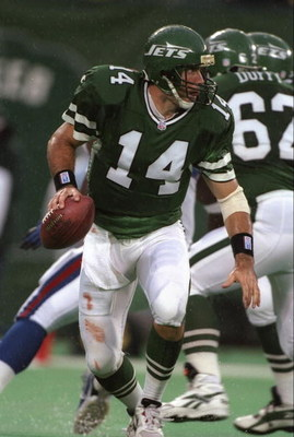 22 Sep 1996:  Quarterback Neil O'Donnelll #14 of the New York Jets looks down field for an open receiver as he drops back to pass during a play in the Jets 13-6 loss to the New York Giants at Giants Stadium in East Rutherford, New Jersey.  Mandatory Credi