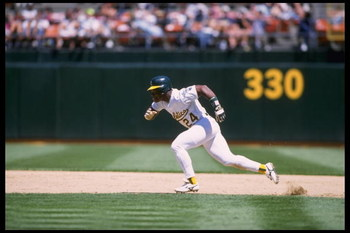 4 Jul 1995:  Left fielder Rickey Henderson #24 of the Oakland Athletics runs to second base against the Milwaukee Brewers at Oakland Alameda Stadium in Oakland, California. The A''s defeated the Brewers 5-3.  Mandatory Credit:  Jed Jacobsohn/Allsport