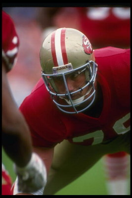 18 Nov 1990:  Defensive lineman Pierce Holt of the San Francisco 49ers looks on during a game against the Tampa Bay Buccaneers at Candlestick Park in San Francisco, California.  The 49ers won the game, 31-7. Mandatory Credit: Otto Greule  /Allsport