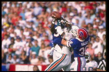 29 Oct 1989: Defensive back Mark Kelso of the Buffalo Bills (right) and Miami Dolphins wide receiver Andre Brown fight for the ball during a game at Rich Stadium in Orchard Park, New York. The Bills won the game, 31-17.