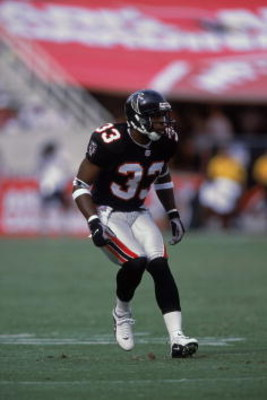 30 Sep 2001:  Ashley Ambrose #33 of the Atlanta Falcons in action during the game against the Arizona Cardinals at the Sun Devil Stadium in Tempe, Arizona.  The Falcons defeated the Cardinals 34-14.Mandatory Credit: Donald Miralle  /Allsport